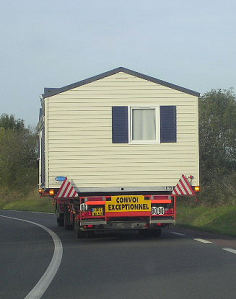 Moving house on back of truck.
